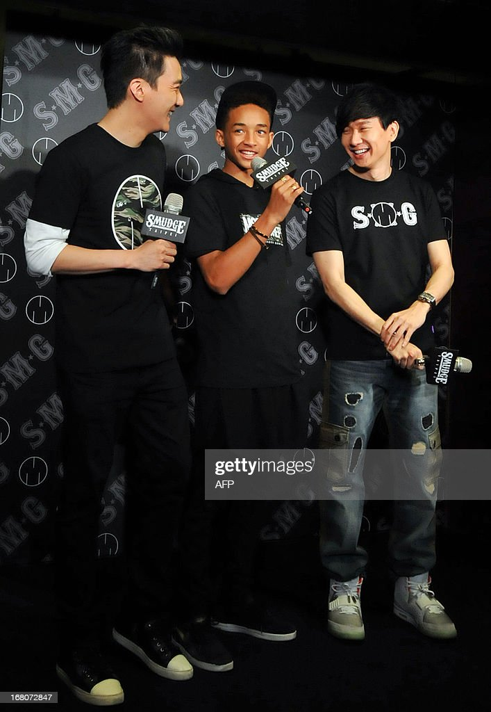 Singapore singer and SMG brand founder JJ Lin (R), US actor and MSFTS REP brand founder Jaden Smith (C) and MSFTS REP Asia representative Brandon Chang (L) attend a press conference in Taipei on May 5, 2013 as the two brands for the first time launched collaboration products in Asia. Hollywood star Will Smith, who arrived in Taiwan on May 2 on a promotional tour for sci-fi flick 'After Earth', said that he will probably shoot a comedy with his son Jaden when they team up for the third time in film-making. AFP PHOTO/ Mandy CHENG