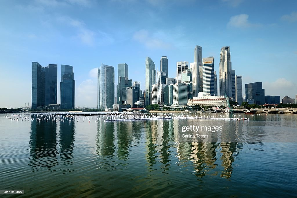 Singapore skyline on a blue sunny day : Stock Photo