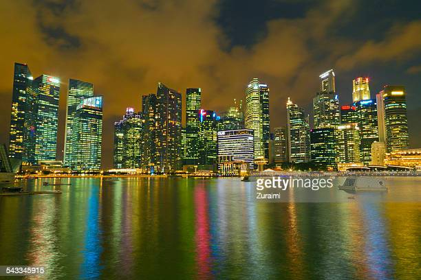 Singapore, Waterfront skyline with illuminated skyscrapers seen from harbor