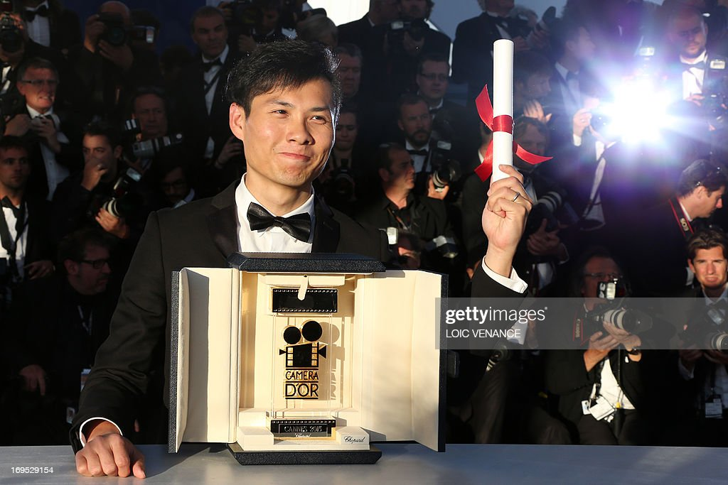 Singaporean director Anthony Chen poses on May 26, 2013 during a photocall after winning the Camera d'Or for Best First Film at the 66th Cannes film festival in Cannes.