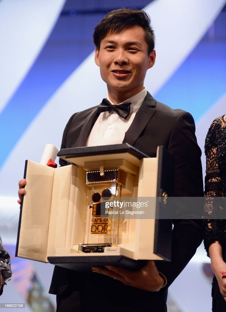 Singaporean director Anthony Chen poses on stage after winning the Camera d'Or for Best First Film at the Inside Closing Ceremony during the 66th Annual Cannes Film Festival at the Palais des Festivals on May 26, 2013 in Cannes, France.