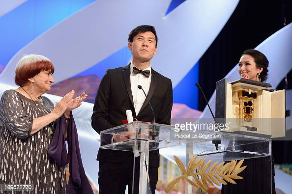 Singaporean director Anthony Chen poses on stage with director Agnes Varda and Chinese actress and member of the Un Certain Regard Jury Zhang Ziyi...