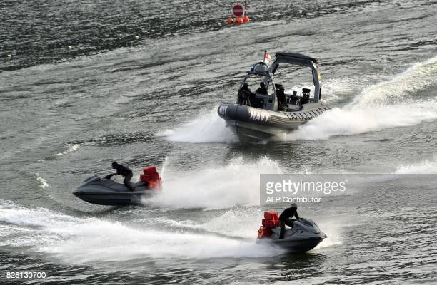 Singaporean navy personnel demonstrate a high speed water chase during the 52nd National Day parade and celebration in Singapore on August 9 2017 /...