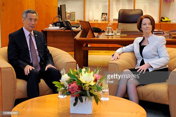 Singaporean Prime Minister Lee Hsien Loong and Australian Prime Minister Julia Gillard pose for photos at Parliament House on October 11 2012 in...