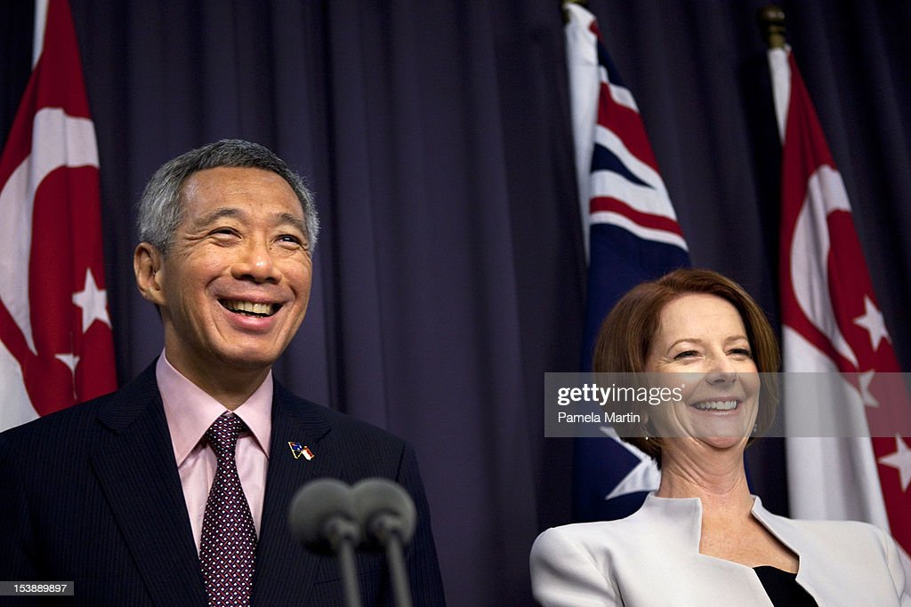 Singaporean Prime Minister <a gi-track='captionPersonalityLinkClicked' href=/galleries/search?phrase=Lee+Hsien+Loong&family=editorial&specificpeople=3911578 ng-click='$event.stopPropagation()'>Lee Hsien Loong</a> and Australian Prime Minister <a gi-track='captionPersonalityLinkClicked' href=/galleries/search?phrase=Julia+Gillard&family=editorial&specificpeople=787281 ng-click='$event.stopPropagation()'>Julia Gillard</a> smile at a press conference at Parliament House on October 11, 2012 in Canberra, Australia. Prime Minister <a gi-track='captionPersonalityLinkClicked' href=/galleries/search?phrase=Lee+Hsien+Loong&family=editorial&specificpeople=3911578 ng-click='$event.stopPropagation()'>Lee Hsien Loong</a> is in Australia for three days for meetings in Canberra and Sydney.