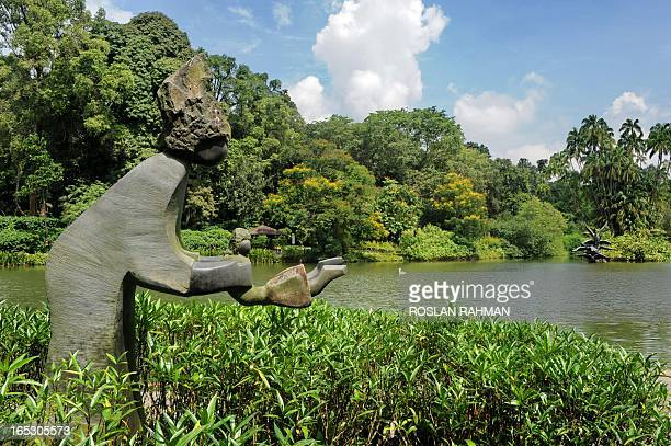 SingaporeenvironmentbotanyUNESCO by Bhavan Jaipragas A sculpture of a mother swings her child sit next to the lake at the Botanical Garden in...