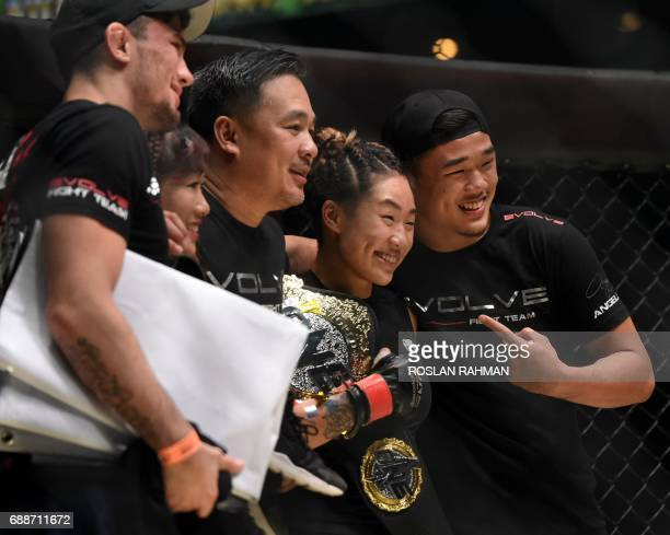 Singapore's Angela Lee celebrates with family members after defeating Brazil's Istela Nunes during the Mixed Martial Art One Womens Atomweight...