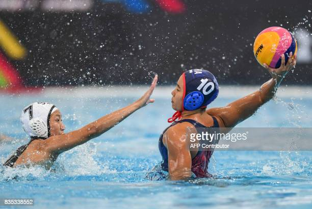Singapore's Angeline Teo Yi Ling fights for posesssion of the ball against Thailand's Sarocha Rewrujirek during their women's water polo round match...