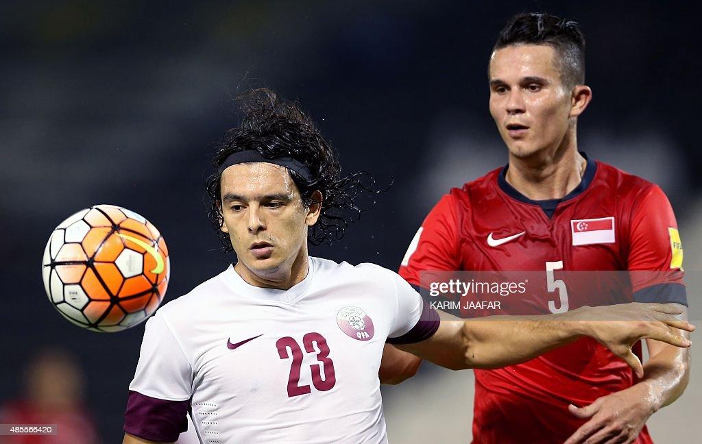 Singapore's Baihakki Bin Khaizan vies with Qatar's Sebastian Soria during their international friendly football match on August 28 2015 at the AlSadd...