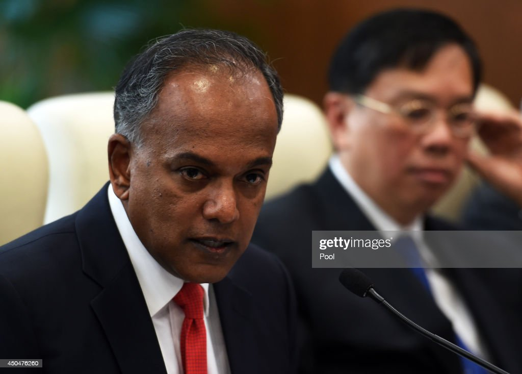 Singapore's Foreign Minister K. Shanmugam (L) speaks during a meeting with Chinese Foreign Minister Wang Yi on June 12, 2014 in Beijing, China.