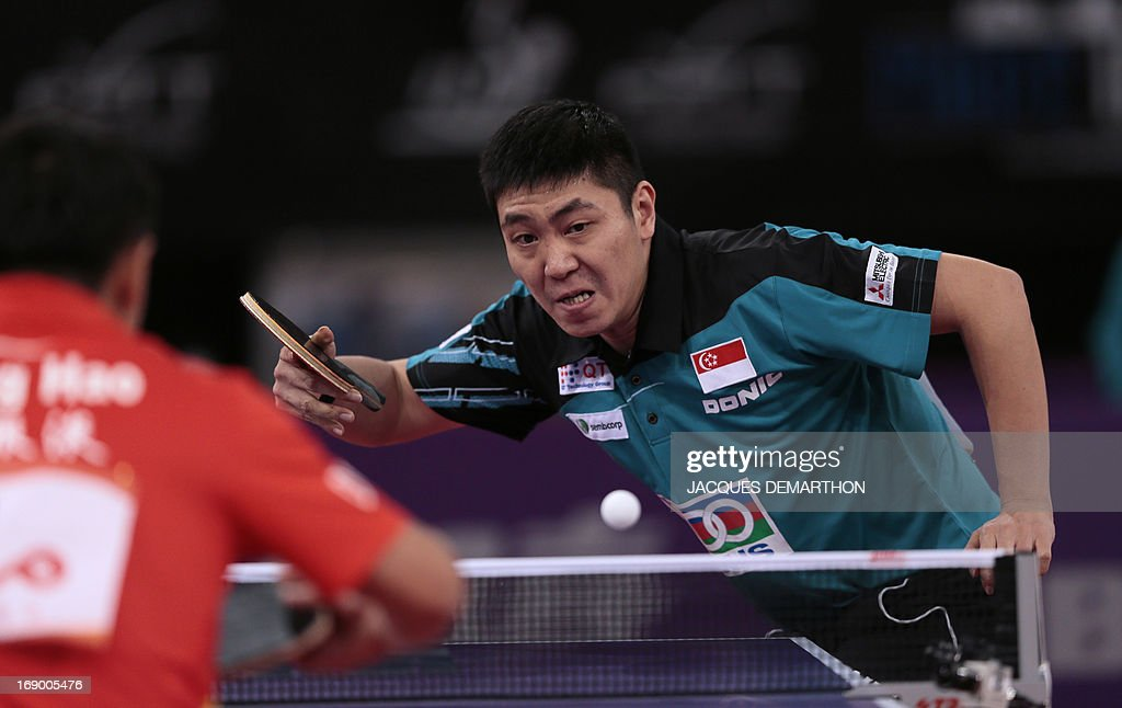 Singapore's Gao Ning serves to China's Wang Hao on May 18, 2013 in Paris during the round of sixteen of the Men's Singles category of the World Table Tennis Championships.
