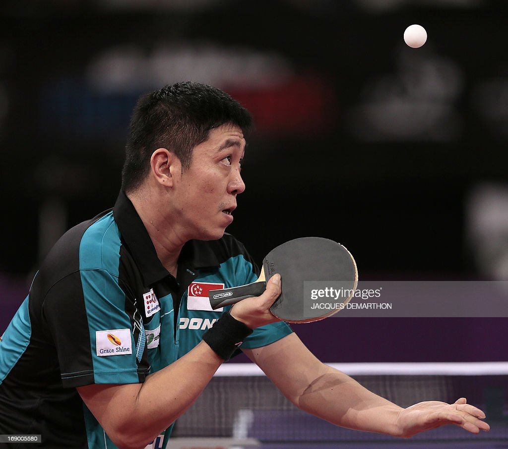 Singapore's Gao Ning serves to China's Wang Hao on May 18, 2013 in Paris during the round of sixteen of the Men's Singles category of the World Table Tennis Championships. AFP PHOTO / JACQUES DEMARTHON
