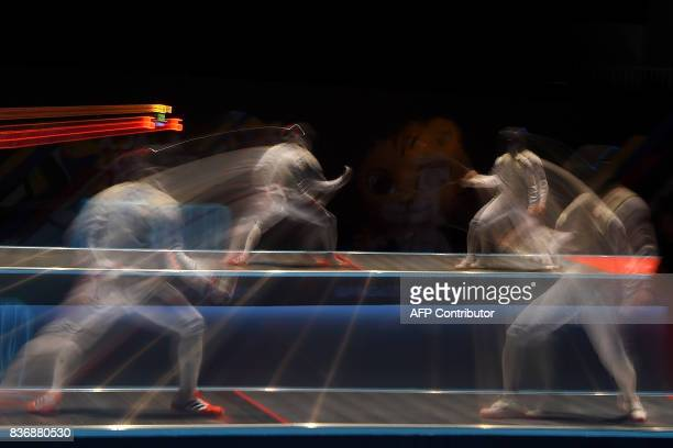 Singapore's Jet Shang Fei competes with Nathaniel Perez of Philippines in the men's fencing foil individual semifinal of the 29th Southeast Asian...