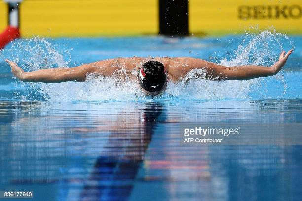 TOPSHOT Singapore's Joseph Schooling competes in the men's 50m butterfly swimming final of the 29th Southeast Asian Games at the National Aquatics...