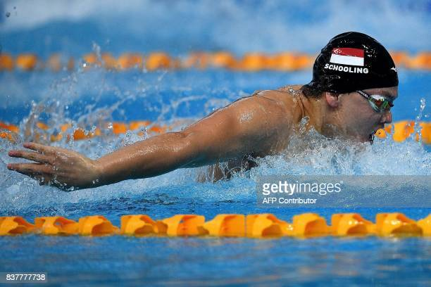 Singapore's Joseph Schooling competes in the men's swimming 100m butterfly final event of the 29th Southeast Asian Games at the National Aquatics...