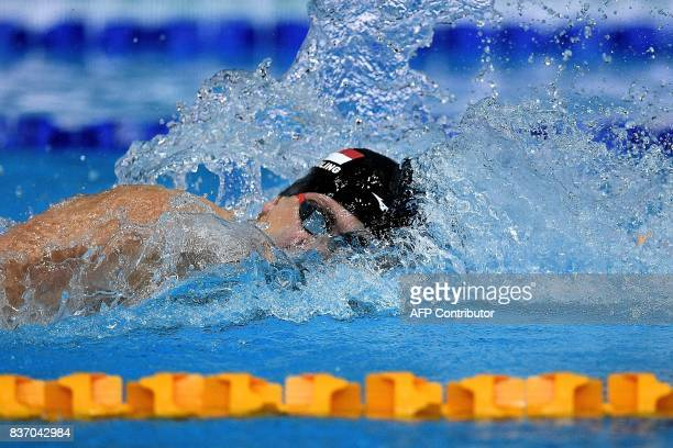 Singapore's Joseph Schooling competes in the men's swimming 4 X 100m freestyle relay final of the 29th Southeast Asian Games at the National Aquatics...