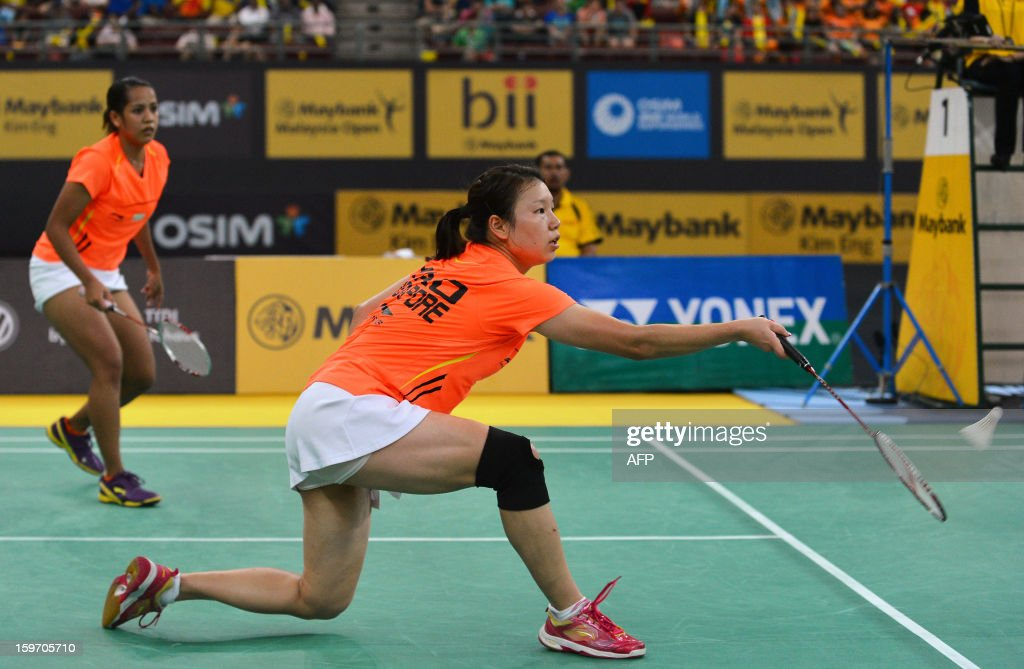 Singapore's Lei Yao (R) hits a shot as partner Shinta Mulia Sari (L) looks on against Japans's Misaki Matsutomo and Ayaka Takahashi during their woman's doubles semi-finals match at the Malaysia Open Badminton Superseries in Kuala Lumpur on January 19, 2013. AFP PHOTO / MOHD RASFAN