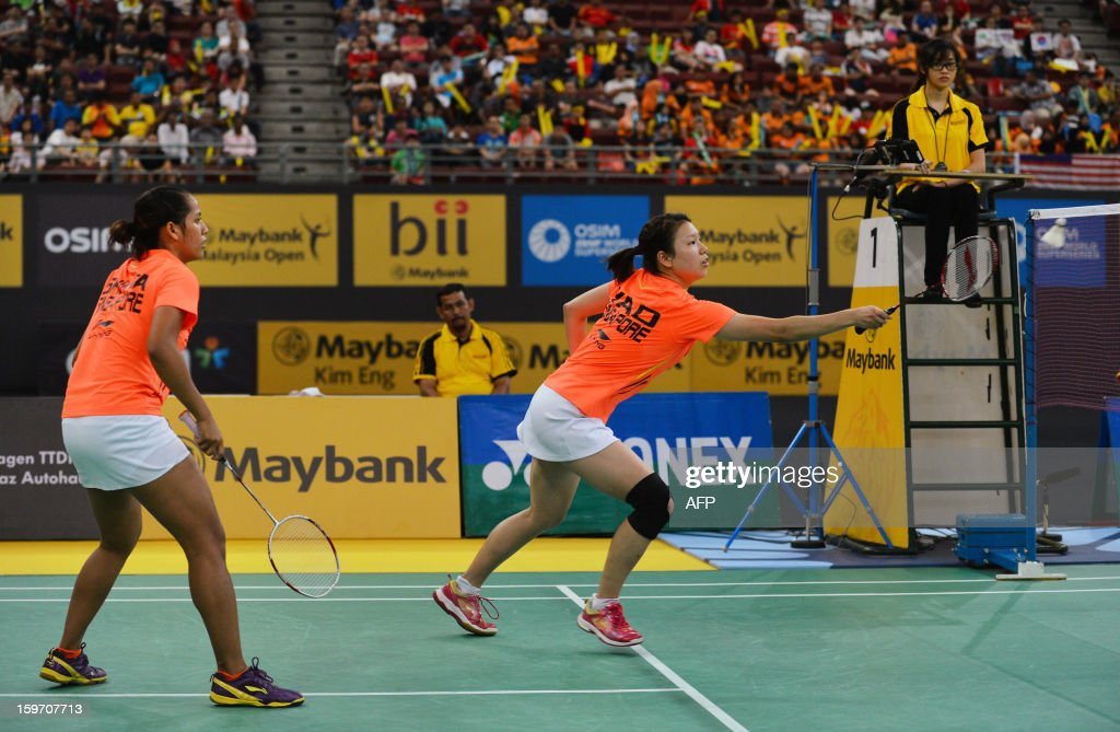 Singapore's Lei Yao (R) hits a shot as partner Shinta Mulia Sari (L) looks on against Japan's Misaki Matsutomo and Ayaka Takahashi during their woman's doubles semi-finals match at the Malaysia Open Badminton Superseries in Kuala Lumpur on January 19, 2013.