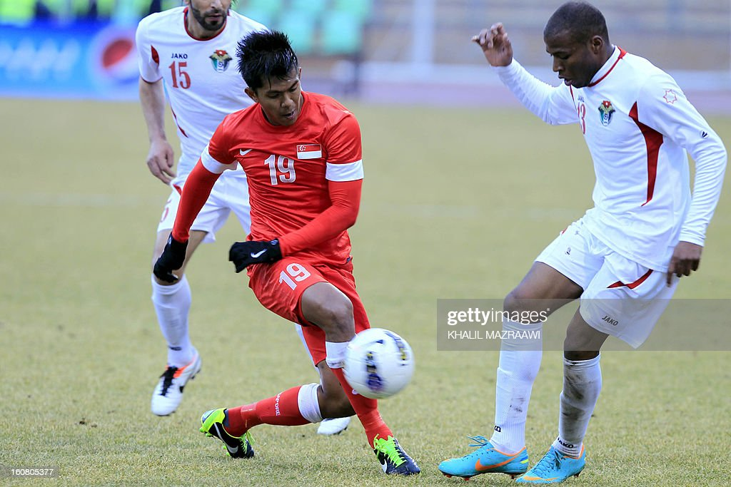 Singapore's Mohammad Khairul Amri Bin Mohammad Kamal (L) vies with Jordan's Khalil Zaid Kh. Baniateyah during the 2015 AFC Asian Cup group A qualifying football match at the King Abdullah International Stadium in the capital Amman, on February 6, 2013.