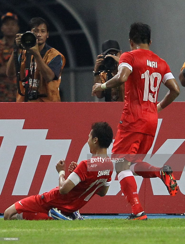 Singapore's player Mohammad Shahril Ishak (C) celebrates his goal against Malaysia during their AFF Suzuki Cup group B football match in Bukit Jalil Stadium outside Kuala Lumpur on November 25, 2012.