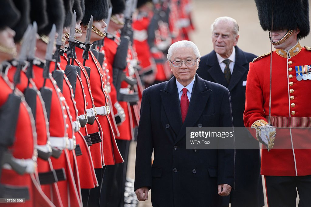Singapore's President Tony Tan Keng Yam (C) reviews an honour guard accompanied by Britain's Prince Philip, Duke of Edinburgh (back 2R) during the ceremonial welcome ceremony for the Singaporean president at the start of a state visit at Horse Guards Parade on October 21, 2014 in London, England. The President is at the beginning of his four day stay during which he will hold a bilateral meeting with Prime Minister David Cameron.