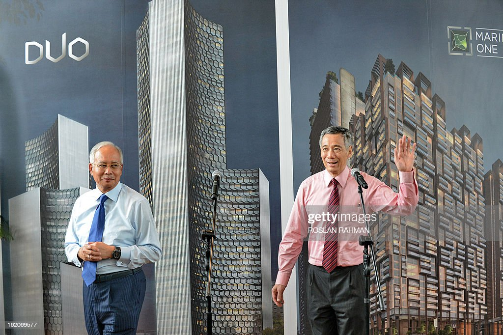 Singapore's Prime Minister Lee Hsien Loong (R) and Malaysia's Prime Minister Najib Razak (L) attend the Marina One unveiling ceremony in Singapore on February 19, 2013. Singapore and Malaysia announced plans February 19 to build a high-speed rail link, fuelling hopes that Southeast Asia could one day enjoy a rapid European-style train system connected to China.
