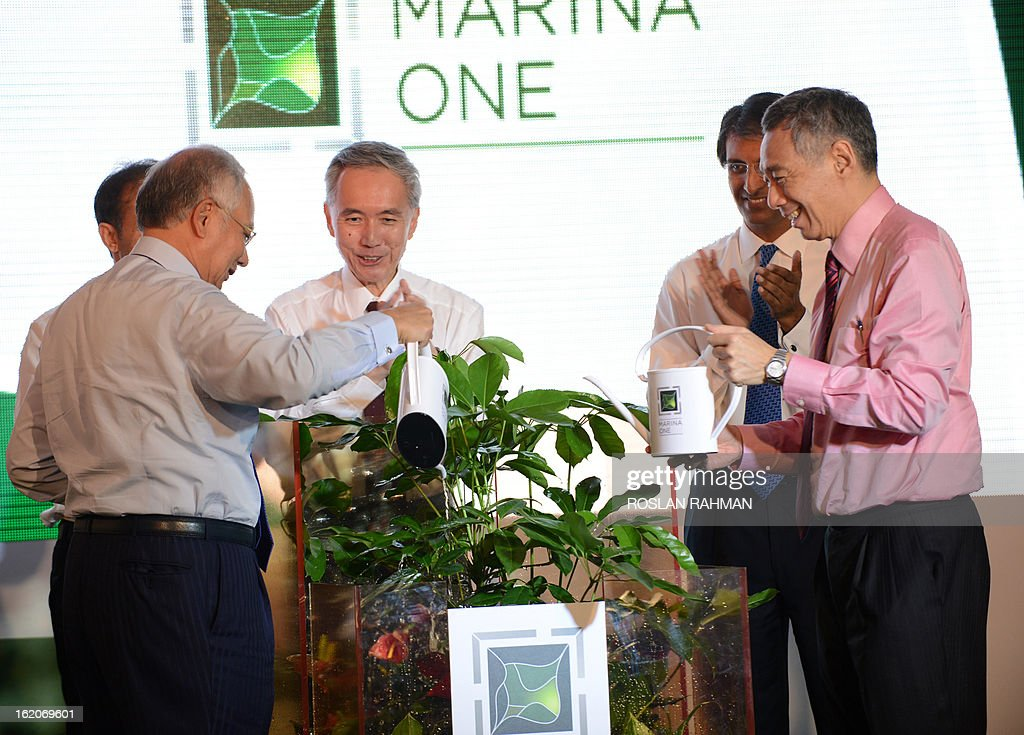Singapore's Prime Minister Lee Hsien Loong (R) and Malaysia's Prime Minister Najib Razak (L) water the plants at the Marina One unveiling ceremony in Singapore on February 19, 2013. Singapore and Malaysia announced plans February 19 to build a high-speed rail link, fuelling hopes that Southeast Asia could one day enjoy a rapid European-style train system connected to China.