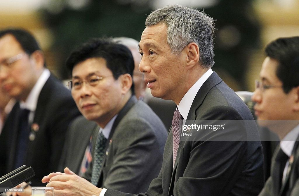 Singapore's Prime Minister <a gi-track='captionPersonalityLinkClicked' href=/galleries/search?phrase=Lee+Hsien+Loong&family=editorial&specificpeople=3911578 ng-click='$event.stopPropagation()'>Lee Hsien Loong</a> (2-R) speaks to Chinese Premier Li Keqiang (not seen) during their meeting at the Great Hall of the People on August 26, 2013 in Beijing, China. Lee is on a seven-day visit to China where he will also visit China's Xinjiang Uygur Autonomous Region and Liaoning Province.
