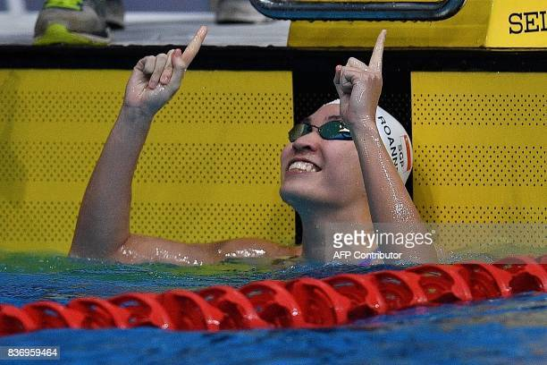 Singapore's Ru'en Roanne Ho reacts after winning the women's 50m breaststroke swimming final of the 29th Southeast Asian Games at the National...