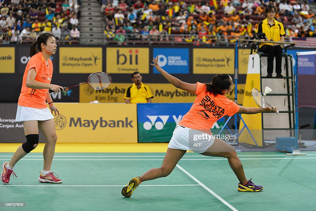 Singapore's Shinta Mulia Sari (R) hits a shot as partner Lei Yao (L) looks on against Japan's Misaki Matsutomo and Ayaka Takahashi during their woman's doubles semi-finals match at the Malaysia Open Badminton Superseries in Kuala Lumpur on January 19, 2013.