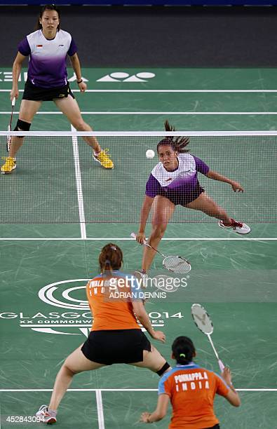 Singapore's Shinta Mulia Sari plays a shot besides her doubles partner Lei Yao against India's Ashwini Ponnappa and Jwala Gutta in the Mixed Team...
