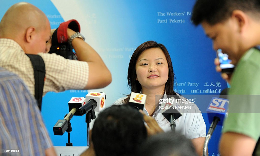 Singapore's Workers' Party (WP) member Lee Li Lian (C) faces the media at the end of a press conference in Singapore on January 14, 2013. Lee was named as the opposition Workers' Party's candidate for the Punggol East by-election on January 26. The January 26 by-election will give a new snapshot of the public mood two years after the People's Action Party (PAP), which has ruled the city-state for more than half a century, suffered its worst ever general election result.