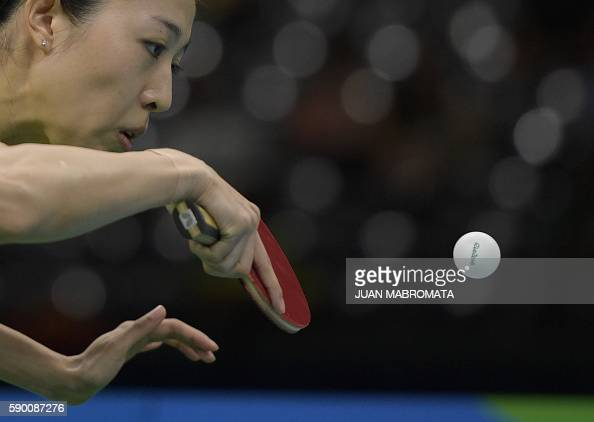 TOPSHOT Singapore's Yu Mengyu hits a shot in the women's team bronze medal table tennis match against Japan at the Riocentro venue during the Rio...
