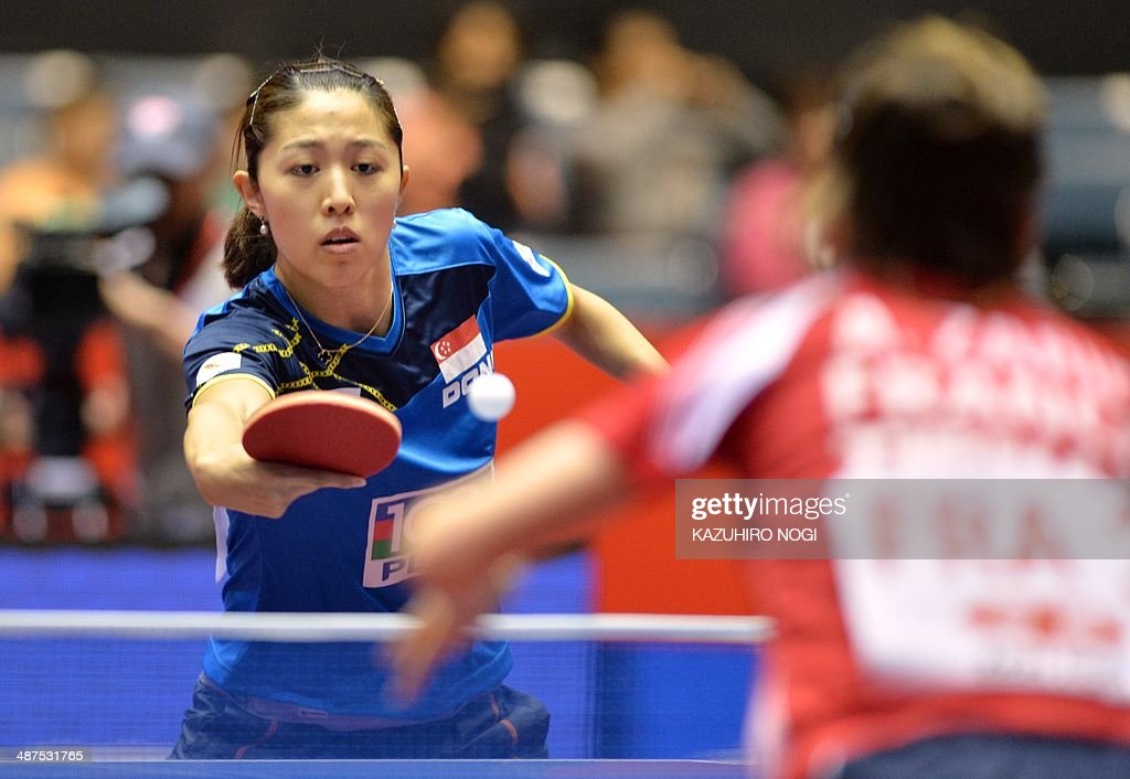 Singapore's Yu Mengyu (L) returns a shot against France's Audrey Zarif during their match in the women's team championship division group C at the 2014 World Team Table Tennis Championships in Tokyo on May 1, 2014.
