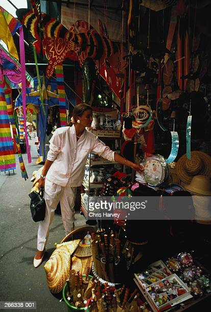Singapore,woman browsing at souvenir stall,Chinatown Market