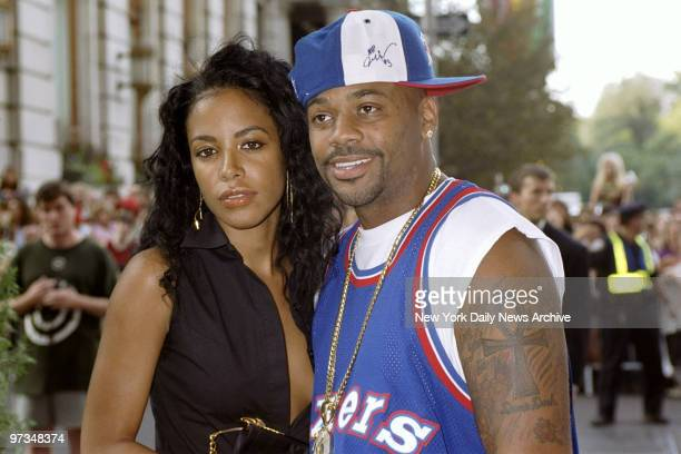 B singer Aaliyah and hiphop mogul Damon Dash are on hand for the premiere of the movie 'The Others' at the Paris Theater