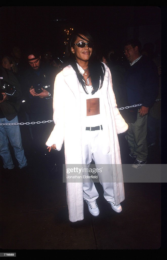 Singer <a gi-track='captionPersonalityLinkClicked' href=/galleries/search?phrase=Aaliyah+-+Singer&family=editorial&specificpeople=207158 ng-click='$event.stopPropagation()'>Aaliyah</a> poses for a picture outside a theater November 9, 1997 at the premiere of ''Anastasia.'' She performs the theme song 'Journey to the Past' which is inspired by her own real-life reunion with a long lost relative.