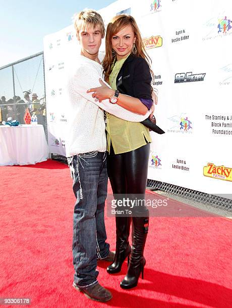 Singer Aaron Carter and dancer Karina Smirnoff attend Children Uniting Nations' 11th Annual 'Day of The Child' at Barkar Hangar on November 22 2009...