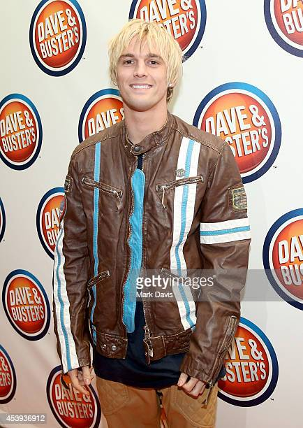 Singer Aaron Carter attends Dave Buster's Hollywood Highland Grand Opening on August 21 2014 in Hollywood California