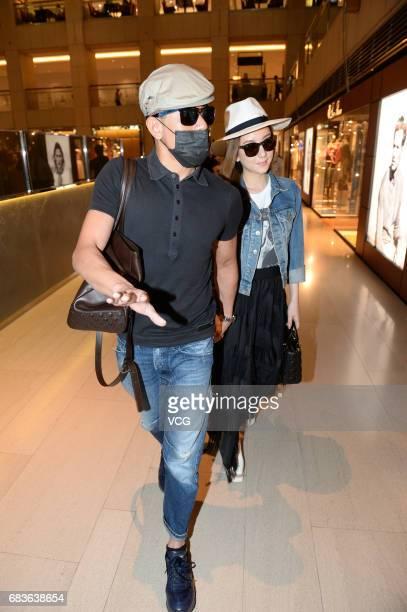Singer Aaron Kwok and wife Fang Yuan walk at a shopping mall on May 13 2017 in Hong Kong China