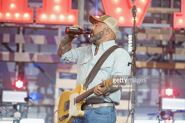Singer Aaron Lewis drinks a beer while performing on the Next From Nashville stage during the Watershed Music Festival at Gorge Amphitheatre on July...