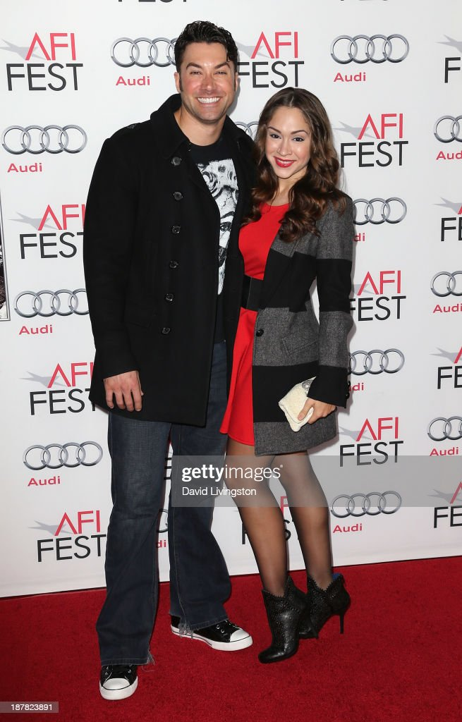 Singer Ace Young (L) and wife singer Diana DeGarmo attend the AFI FEST 2013 presented by Audi premiere of 'Lone Survivor' at the TCL Chinese Theatre on November 12, 2013 in Hollywood, California.