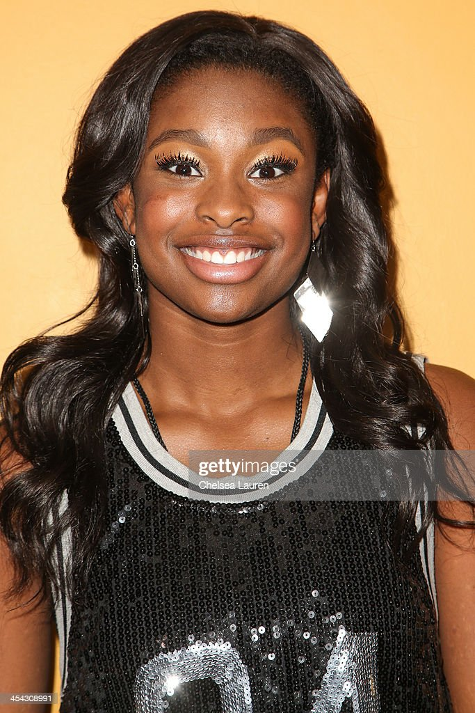 Singer / actress <a gi-track='captionPersonalityLinkClicked' href=/galleries/search?phrase=Coco+Jones&family=editorial&specificpeople=4684153 ng-click='$event.stopPropagation()'>Coco Jones</a> arrives at The Salvation Army's 4th annual Rock The Red Kettle concert at 5 Towers Outdoor Concert Arena on December 7, 2013 in Universal City, California.