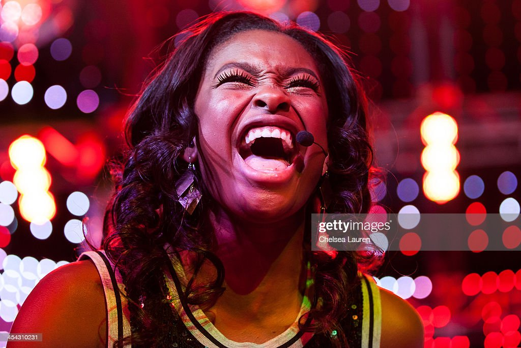 Singer / actress <a gi-track='captionPersonalityLinkClicked' href=/galleries/search?phrase=Coco+Jones&family=editorial&specificpeople=4684153 ng-click='$event.stopPropagation()'>Coco Jones</a> performs at The Salvation Army's 4th annual Rock The Red Kettle concert at 5 Towers Outdoor Concert Arena on December 7, 2013 in Universal City, California.