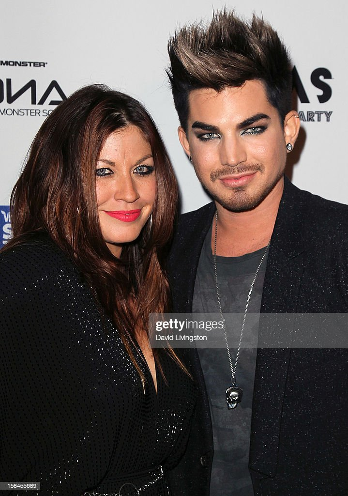 Singer Adam Lambert (R) and guest attend the VH1 Divas After Party to benefit the VH1 Save The Music Foundation at the Shrine Expo Hall on December 16, 2012 in Los Angeles, California.