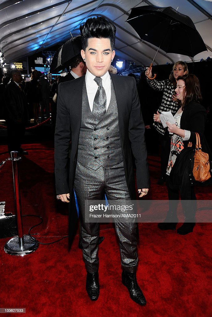 Singer <a gi-track='captionPersonalityLinkClicked' href=/galleries/search?phrase=Adam+Lambert&family=editorial&specificpeople=5706674 ng-click='$event.stopPropagation()'>Adam Lambert</a> arrives at the 2011 American Music Awards held at Nokia Theatre L.A. LIVE on November 20, 2011 in Los Angeles, California.