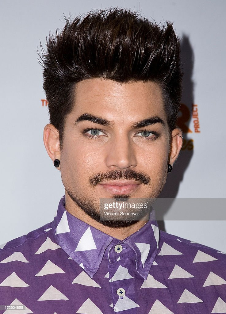 Singer <a gi-track='captionPersonalityLinkClicked' href=/galleries/search?phrase=Adam+Lambert&family=editorial&specificpeople=5706674 ng-click='$event.stopPropagation()'>Adam Lambert</a> attends the <a gi-track='captionPersonalityLinkClicked' href=/galleries/search?phrase=Adam+Lambert&family=editorial&specificpeople=5706674 ng-click='$event.stopPropagation()'>Adam Lambert</a> performance and check donation presentation to The Trevor Project for 'Live Proud' Campaign at Playhouse Hollywood on July 3, 2013 in Los Angeles, California.