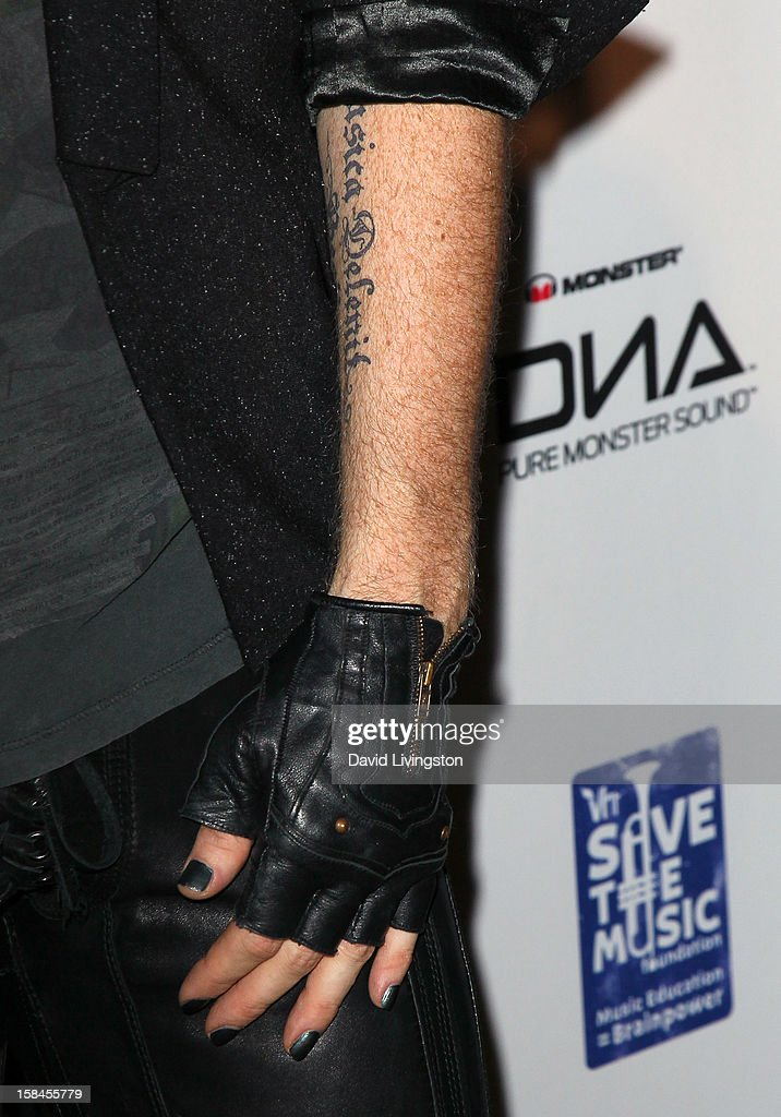 Singer Adam Lambert (tattoo, glove & fingernail detail) attends the VH1 Divas After Party to benefit the VH1 Save The Music Foundation at the Shrine Expo Hall on December 16, 2012 in Los Angeles, California.