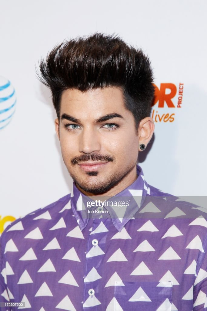 Singer Adam Lambert attneds Adam Lambert Performance And Check Donation Presentation To The Trevor Project For 'Live Proud' Campaign at Playhouse Hollywood on July 3, 2013 in Los Angeles, California.