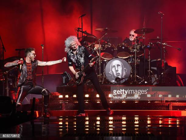 Singer Adam Lambert guitarist Brian May and drummer Roger Taylor perform with Queen at Prudential Center on July 26 2017 in Newark New Jersey